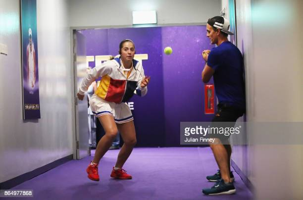 Jelena Ostapenko of Latvia warms up backstage before her singles match against Garbine Muguruza of Spain during day 1 of the BNP Paribas WTA Finals...