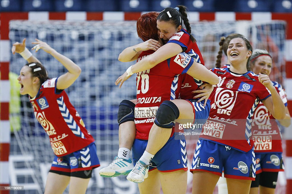 Jelena Popovic and Biljana Filipovic of Serbia celebrate victory against Denmark after the Women's European Handball Championship 2012 Group I main round match between Serbia and Denmark at Arena Hall on December 11, 2012 in Belgrade, Serbia.