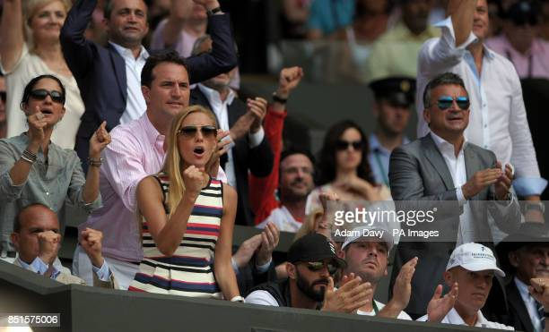Jelena Ristic cheers on boyfriend Serbia's Novak Djokovic during his match against Great Britain's Andy Murray on day thirteen of the Wimbledon...