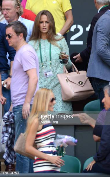 Jelena Ristic is watched by Kim Sears before the Men's Singles Final between their boyfriends Novak Djokovic and Andy Murray on Day 13 of the...