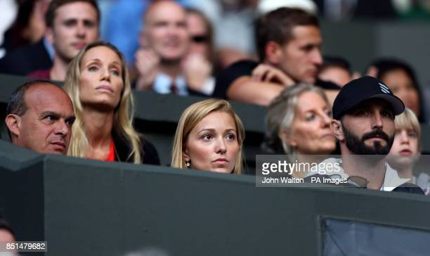 Jelena Ristic watches the match between Serbia's Novak Djokovic and Germany's Tommy Haas during day seven of the Wimbledon Championships at The All...