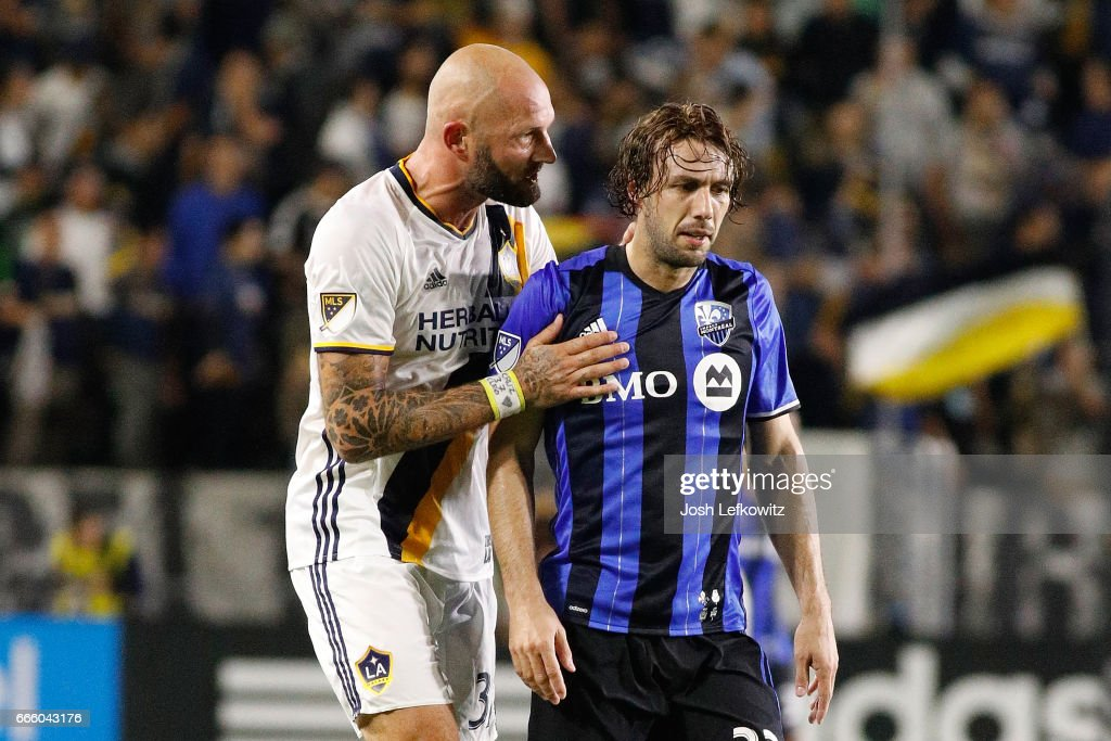 Jelle Van Damme #37 of the Los Angeles Galaxy speaks to Marco Donadel #33 of the Montreal Impact during the Los Angeles Galaxy's MLS match against Montreal Impact at the StubHub Center on April 7, 2017 in Carson, California.