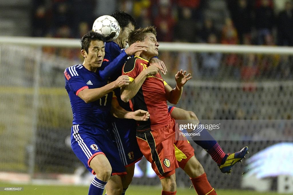 Jelle Vossen of Belgium and Hasebe Makoto of Japan pictured during the international friendly match before the World Cup in Brasil between Belgium and Japan on November 19, 2013 in Brussels, Belgium