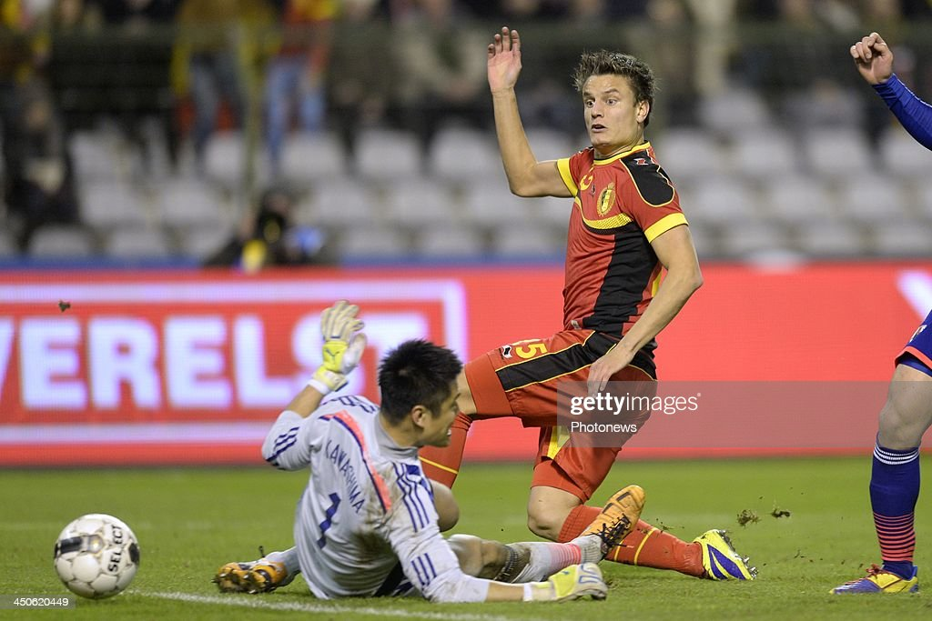 Jelle Vossen of Belgium tries to score against Kawahima Eiji of Japan during the international friendly match before the World Cup in Brasil between Belgium and Japan on November 19, 2013 in Brussels, Belgium