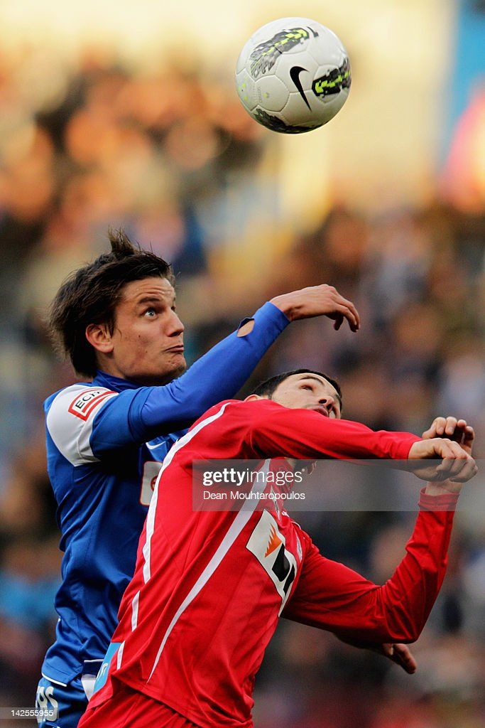 <a gi-track='captionPersonalityLinkClicked' href=/galleries/search?phrase=Jelle+Vossen&family=editorial&specificpeople=5881854 ng-click='$event.stopPropagation()'>Jelle Vossen</a> of Genk and Juan Alberto Andreu of Gent battle for the ball during the Jupiler League match between KRC Genk and KAA Gent at the Cristal Arena on April 7, 2012 in Genk, Belgium.