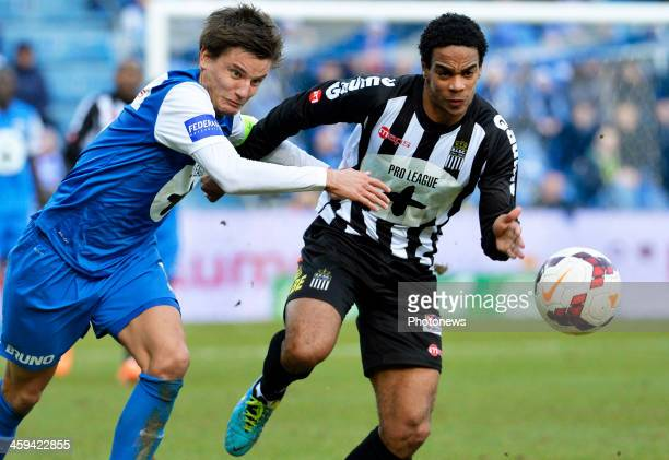 Jelle Vossen of KRC Genk vies with Jonathan Vervoort of Charleroi during the Jupiler League match between KRC Genk and RCSC Charleroi on December 26...