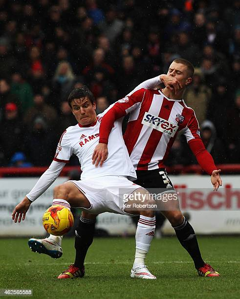 Jelle Vossen of Middlesbrough holds off the challenge of Jake Bidwell of Brentford during the Sky Bet Championship match between Brentford and...