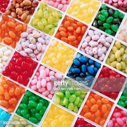 Jelly beans in tray separated by colour, overhead view : Stock Photo