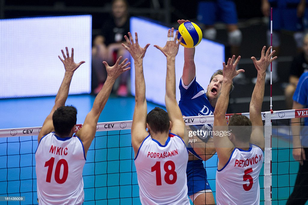Jelte Maan of The Netherlands vies against Serbia's players Milos Nikic Marko Podrascanin and Vlado Petkovic during the Velux Euro Volley 2013...