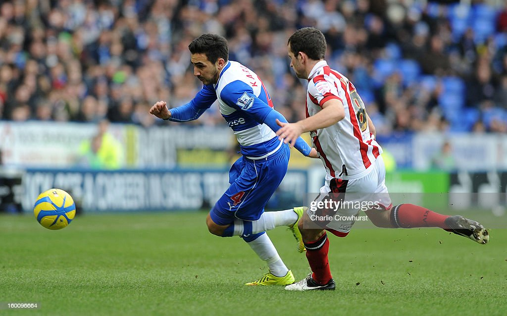 Jem Karacan of Reading attacks during the FA Cup Fourth Round match between Reading and Sheffield United at the Madejski Stadium on January 26, 2013 in London England.