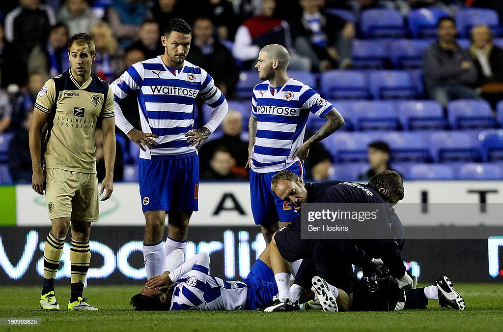 Jem Karacan of Reading lies injured during the Sky Bet Championship match between Reading and Leeds United at Madejski Stadium on September 18, 2013 in Reading, England.