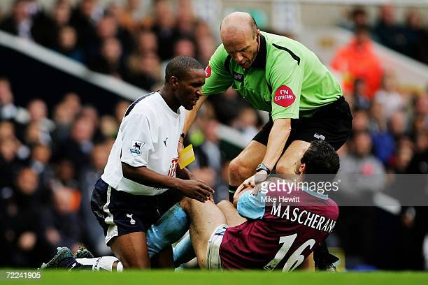 Jemain Defoe of Tottenham and Javier Mascherano of West Ham are separated by referee Steve Bennett during the Barclays Premiership match between...