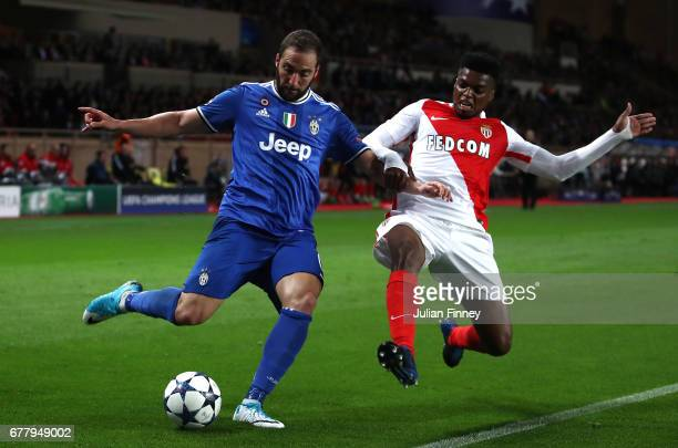 Jemerson of AS Monaco tackles Gonzalo Higuain of Juventus during the UEFA Champions League Semi Final first leg match between AS Monaco v Juventus at...