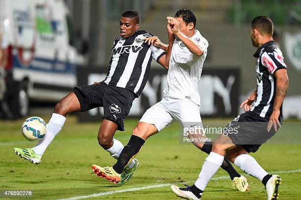 Jemerson of Atletico MG and Ricardo Oliveira of Santos battle for the ball during a match between Atletico MG and Santos as part of Brasileirao...