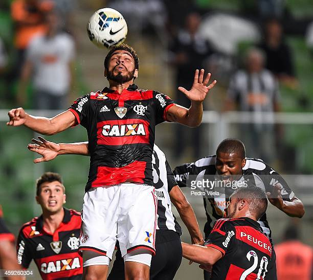 Jemerson of Atletico MG and Wallace and Canteros of Flamengo battle for the ball during a match between Atletico MG and Flamengo as part of...