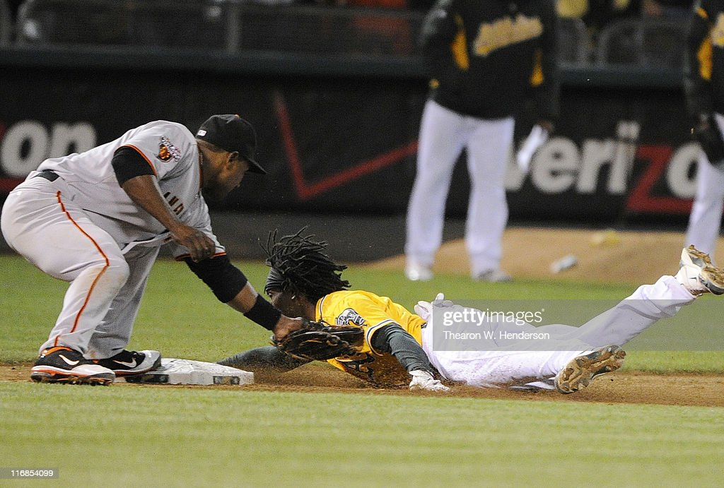 Jemile Weeks #19 of the Oakland Athletics, attempting to stretch a double into a triple, is tagged out at third base by <a gi-track='captionPersonalityLinkClicked' href=/galleries/search?phrase=Miguel+Tejada&family=editorial&specificpeople=202227 ng-click='$event.stopPropagation()'>Miguel Tejada</a> #10 of the San Francisco Giants in the eighth inning during a MLB baseball game June 17, 2011 at the Oakland-Alameda County Coliseum in Oakland, California. The Athletics won the game 5-2.