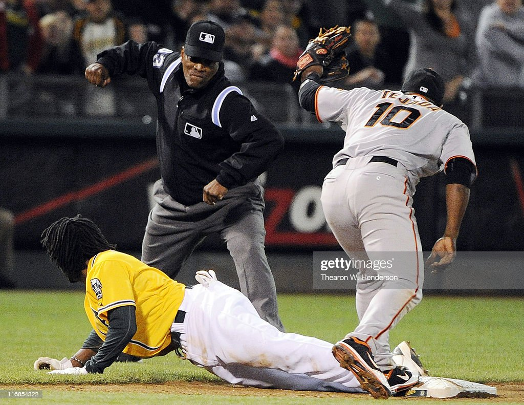 Jemile Weeks #19 of the Oakland Athletics, attempting to stretch a double into a triple, has the tag put on him by <a gi-track='captionPersonalityLinkClicked' href=/galleries/search?phrase=Miguel+Tejada&family=editorial&specificpeople=202227 ng-click='$event.stopPropagation()'>Miguel Tejada</a> #10 of the San Francisco Giants and is called out by third base umpire Lazaro Diaz #63 in the eighth inning during a MLB baseball game June 17, 2011 at the Oakland-Alameda County Coliseum in Oakland, California. The Athletics won the game 5-2.