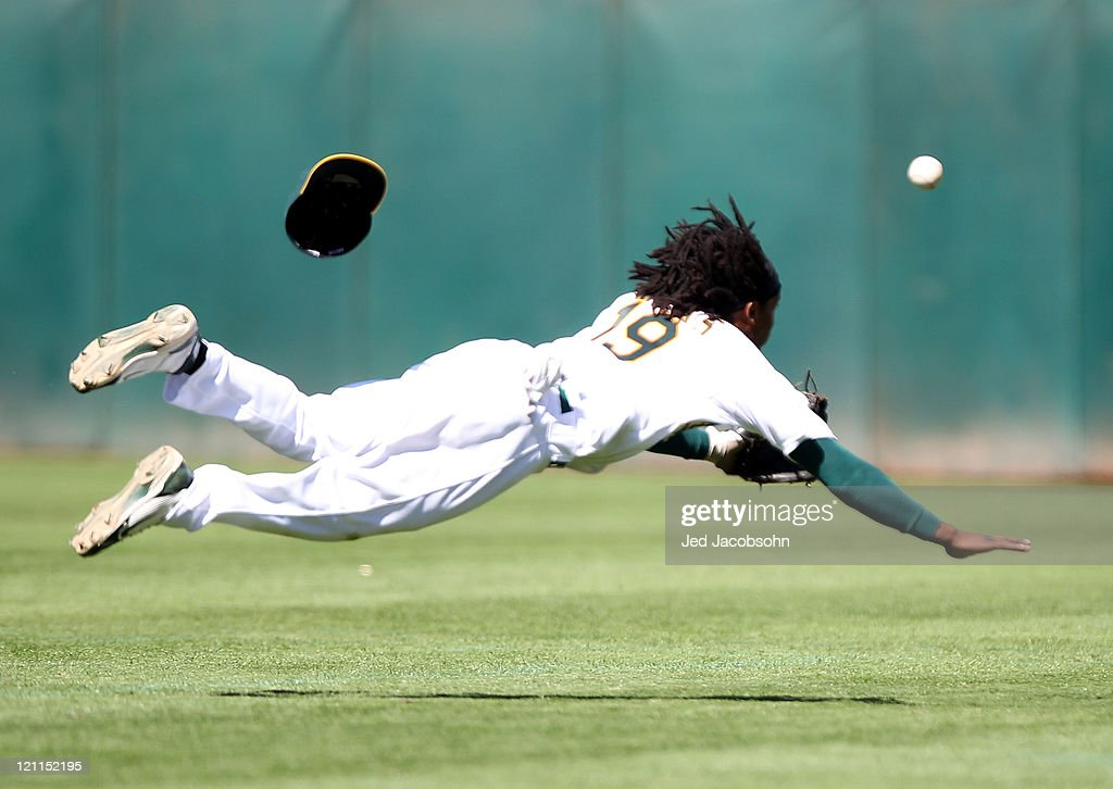 <a gi-track='captionPersonalityLinkClicked' href=/galleries/search?phrase=Jemile+Weeks&family=editorial&specificpeople=4583261 ng-click='$event.stopPropagation()'>Jemile Weeks</a> #19 of the Oakland Athletics can't reach a single by Yorvit Torrealba #8 of the Texas Rangers at O.co Coliseum on August 14, 2011 in Oakland, California.