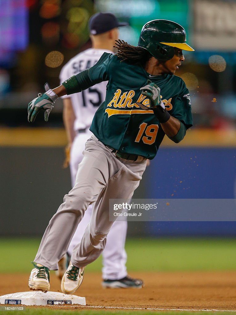 Jemile Weeks #19 of the Oakland Athletics heads home to score on an RBI single by Alberto Callaspo in the fifth inning against the Seattle Mariners at Safeco Field on September 29, 2013 in Seattle, Washington. The Athletics defeated the Mariners 9-0.