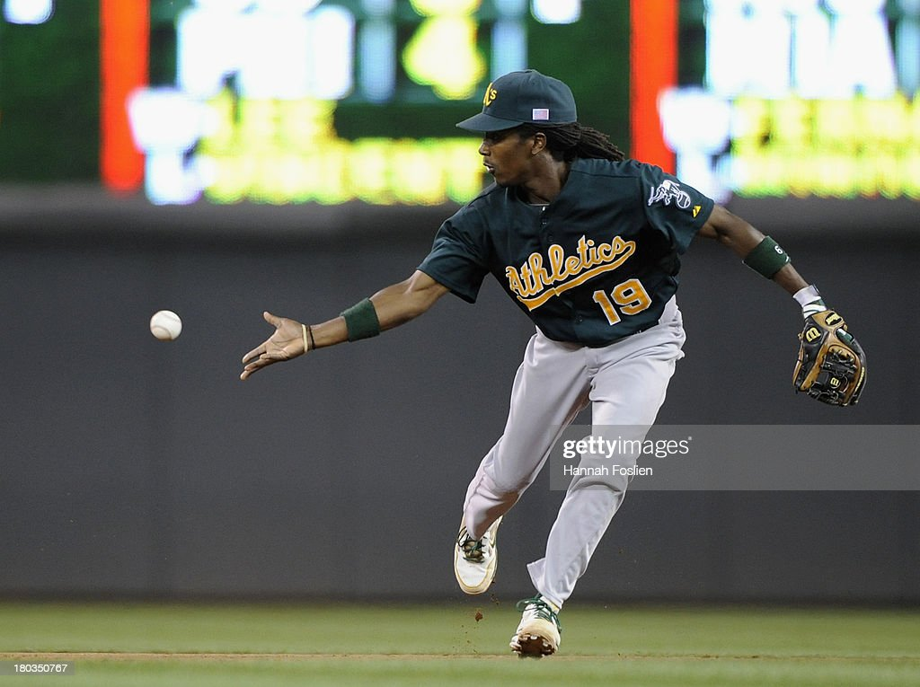 <a gi-track='captionPersonalityLinkClicked' href=/galleries/search?phrase=Jemile+Weeks&family=editorial&specificpeople=4583261 ng-click='$event.stopPropagation()'>Jemile Weeks</a> #19 of the Oakland Athletics makes a play at second base to get out Doug Bernier #17 of the Minnesota Twins at second base during the eighth inning of the game on September 11, 2013 at Target Field in Minneapolis, Minnesota. The Athletics defeated the Twins 18-3.
