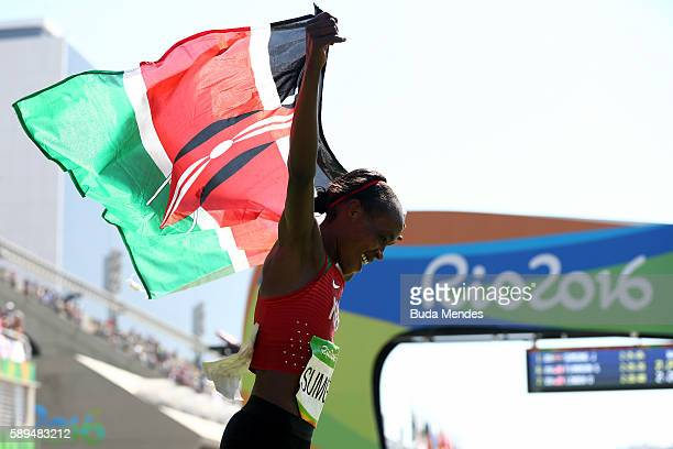 Jemima Jelagat Sumgong of Kenya celebrates after winning the gold medal in the Women's Marathon on Day 9 of the Rio 2016 Olympic Games at the...