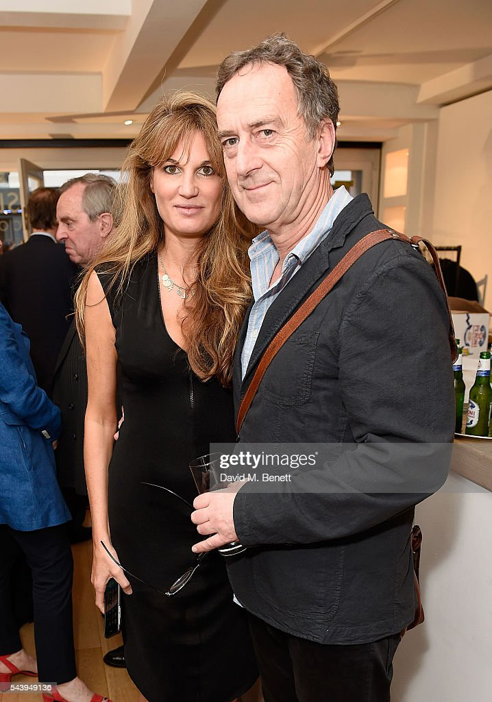 Jemima Khan and <a gi-track='captionPersonalityLinkClicked' href=/galleries/search?phrase=Angus+Deayton&family=editorial&specificpeople=213542 ng-click='$event.stopPropagation()'>Angus Deayton</a> attend the exhibition launch party of 'The Zero Hour Panoramas' by Jolyon Fenwick. The exhibition consists of 14 photographic panoramas showcasing, '100 Years on: Views From The Parapet of the Somme', at Sladmore Contemporary on June 30, 2016 in London, England.
