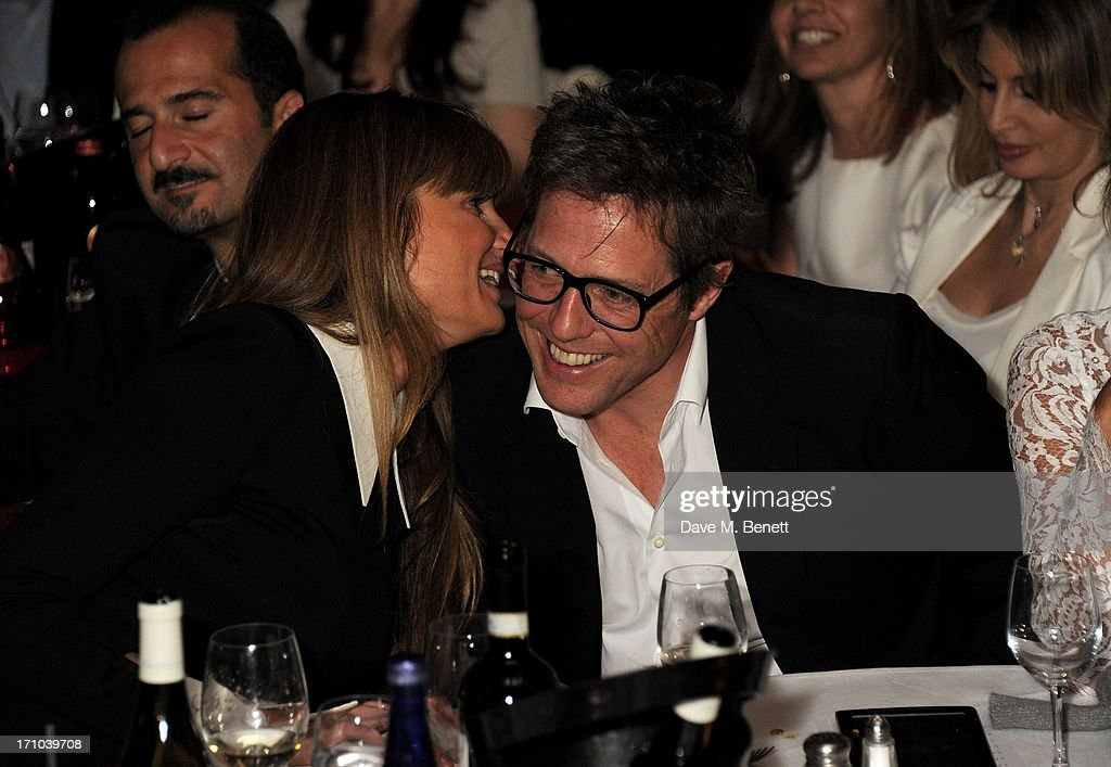 REQUIRED) <a gi-track='captionPersonalityLinkClicked' href=/galleries/search?phrase=Jemima+Khan&family=editorial&specificpeople=206925 ng-click='$event.stopPropagation()'>Jemima Khan</a> (L) and Hugh Grant attend the Hoping Foundation's 'Rock On' benefit evening for Palestinian refugee children at Cafe de Paris on June 20, 2013 in London, England.