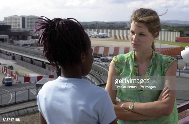 Jemima Khan UNICEF UK Special Representative talking to a girl trafficked from Nigeria to the UK at Gatwick Airport one of the main gateways for...