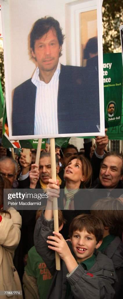 Jemima Khan's son Kasim holds a placard showing his father Imran Khan during a protest calling for democracy in Pakistan on November 10 2007 in...