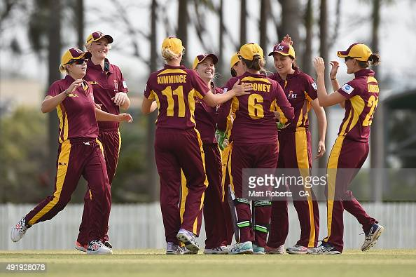 Jemma Barsby of the Fire celebrates a wicket with team mates during the round one WNCL match between Queensland and Victoria at Allan Border Field on...