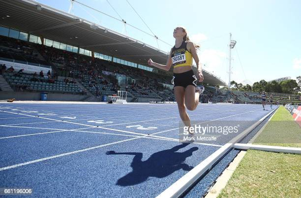 Jemma Crosby of WA wins the womens under 15s 1500m during day six of the Australian Athletics Championships at Sydney Olympic Park Athletic Centre on...