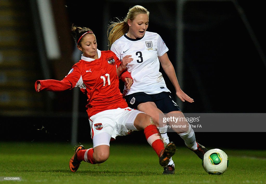 Jemma Purfield of England tackled by Nina Wasserbauer of Austria during the UEFA Womens U17 Championship Finals match between England and Austria at Chesterfield FC Stadium on November 29, 2013 in Chesterfield, England.