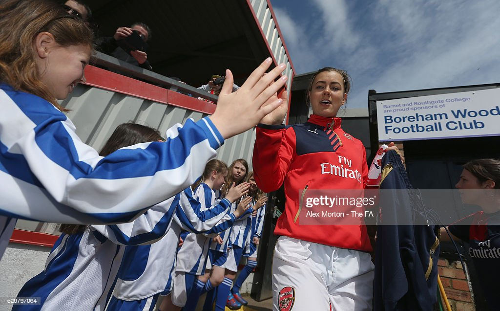 Jemma Rose of Arsenal greets the mascots prior to the WSL match between Arsenal Ladies and Birmingham City Ladies at Meadow Park on May 1, 2016 in Borehamwood, England.