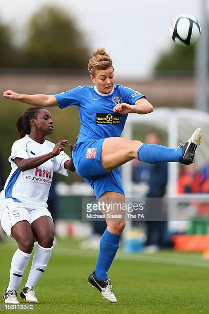 Jemma Rose of Bristol Academy Women's FC clears from Eni Aluko of Birmingham City Ladies FC during the FA WSL match between Bristol Academy Women's...