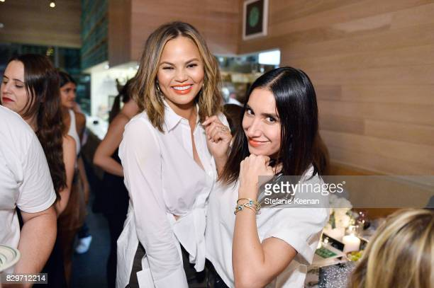 Jen Aitkin and Chrissy Teigen attend INTERMIX x ALC 'On Duty' Launch Dinner with Chrissy Teigen at Jon and Vinny's on August 10 2017 in Los Angeles...