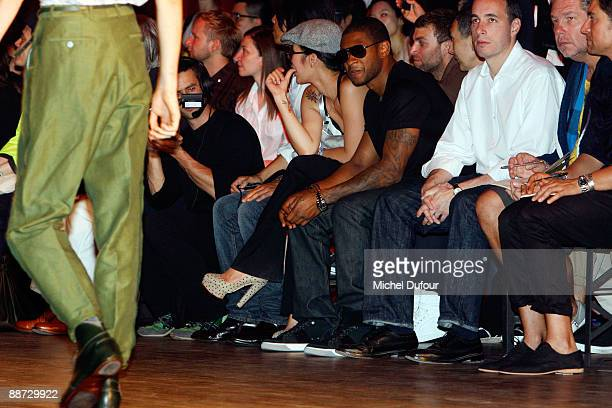 Jen Bui and Usher attend the Lanvin menswear fashion show during Paris Menswear Fashion Week on June 28 2009 in Paris France