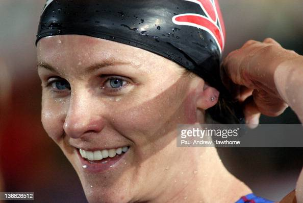 Jen Thompson is all smiles after winning the Women's 50 SC Meter Butterfly of the Saturday Finals during the 2004 FINA Swimming World Cup in East...