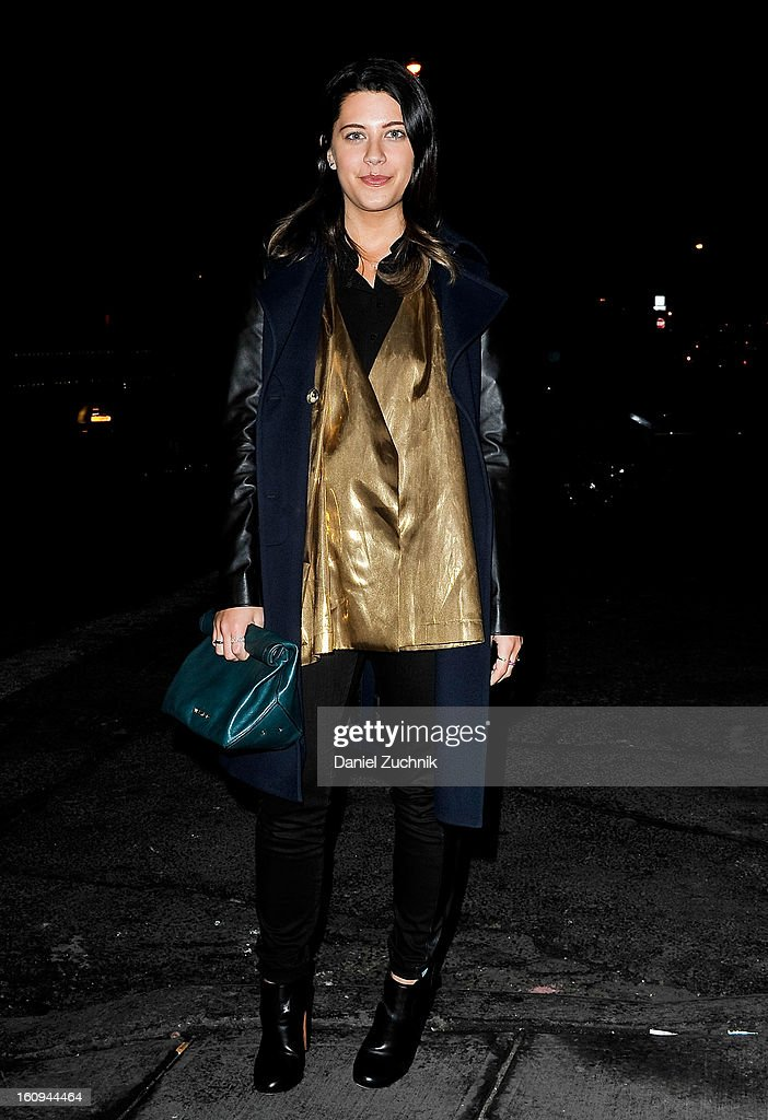 Jena Gambaccini, fashion blogger from Chicago, seen outside the Scoop party wearing a Barneys jacket, Tome gold shirt, Current Elliot pants and Alaia shoes on February 7, 2013 in New York City.