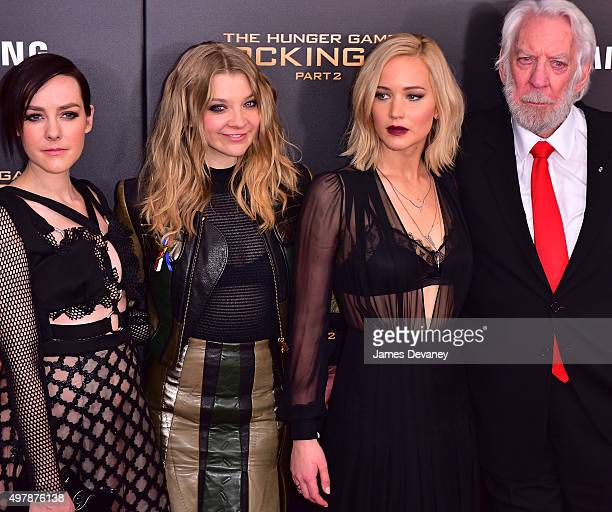 Jena Malone Natalie Dormer Jennifer Lawrence and Donald Sutherland attend the 'The Hunger Games Mockingjay Part 2' New York premiere at AMC Loews...