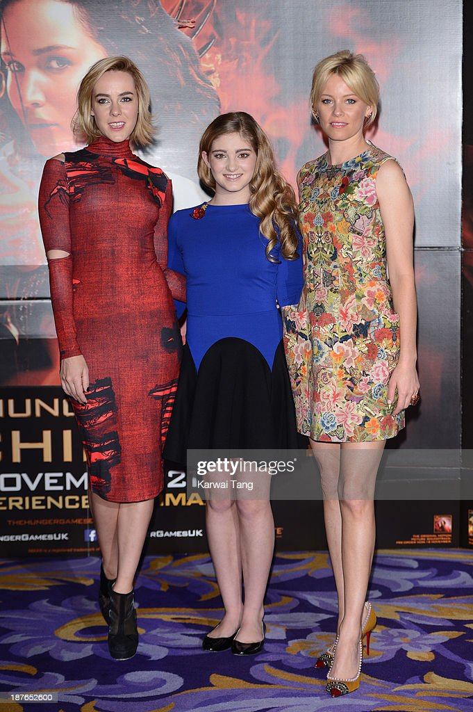 <a gi-track='captionPersonalityLinkClicked' href=/galleries/search?phrase=Jena+Malone&family=editorial&specificpeople=216548 ng-click='$event.stopPropagation()'>Jena Malone</a>, <a gi-track='captionPersonalityLinkClicked' href=/galleries/search?phrase=Willow+Shields&family=editorial&specificpeople=8563210 ng-click='$event.stopPropagation()'>Willow Shields</a> and <a gi-track='captionPersonalityLinkClicked' href=/galleries/search?phrase=Elizabeth+Banks&family=editorial&specificpeople=202475 ng-click='$event.stopPropagation()'>Elizabeth Banks</a> attend a photocall for 'The Hunger Games: Catching Fire' held at the Corinthia Hotel on November 11, 2013 in London, England.