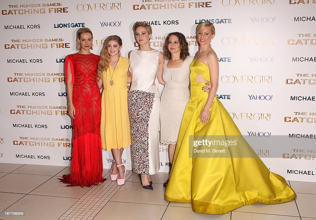 Jena Malone, Willow Shields, Jennifer Lawrence, Nina Jacobson and Elizabeth Banks attend the UK Premiere of 'The Hunger Games: Catching Fire' at Odeon Leicester Square on November 11, 2013 in London, England.