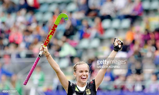 Jena Teschka of Germany cheers after the 31 score against SouthAfrica during a group stage match in the women's tournament of the Field Hockey World...