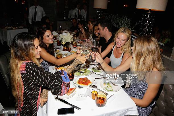 Jenah Yamamoto Kyra Santoro Bryana Holly and designer Tori Praver attend Tori Praver's 2015 Collection Dinner during Miami Swim Week at Dolce Rooftop...