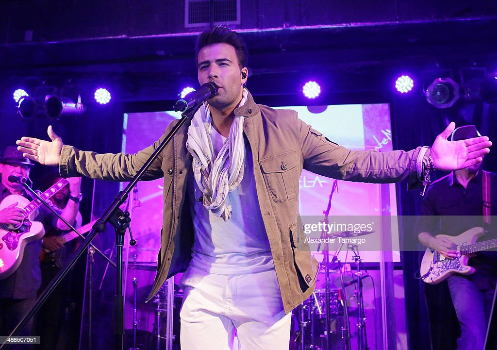 <a gi-track='captionPersonalityLinkClicked' href=/galleries/search?phrase=Jencarlos+Canela&family=editorial&specificpeople=4290761 ng-click='$event.stopPropagation()'>Jencarlos Canela</a> performs his new album 'Jen' at The Stage on May 6, 2014 in Miami, Florida.