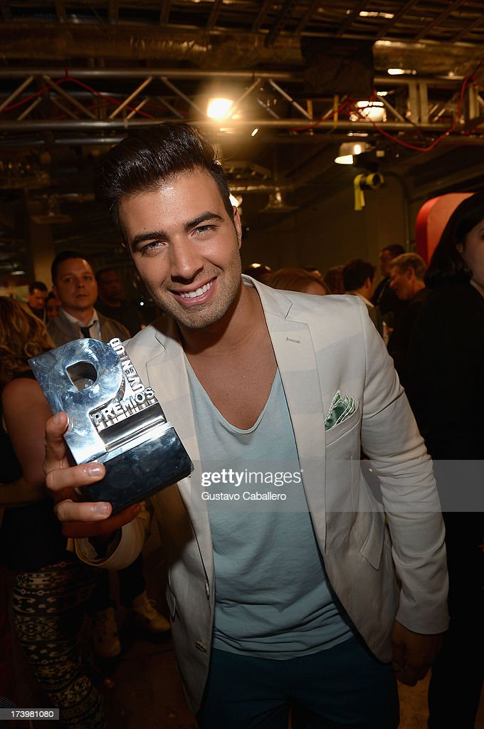 <a gi-track='captionPersonalityLinkClicked' href=/galleries/search?phrase=Jencarlos+Canela&family=editorial&specificpeople=4290761 ng-click='$event.stopPropagation()'>Jencarlos Canela</a> poses backstage during the Premios Juventud 2013 at Bank United Center on July 18, 2013 in Miami, Florida.