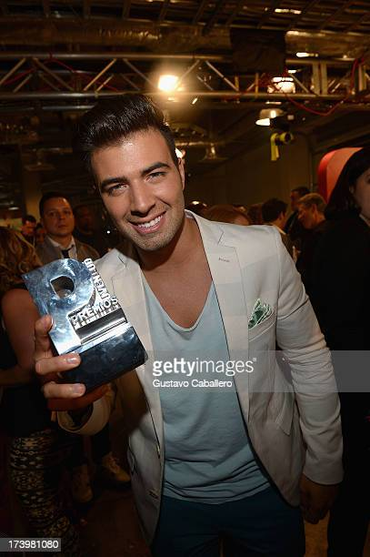 Jencarlos Canela poses backstage during the Premios Juventud 2013 at Bank United Center on July 18 2013 in Miami Florida
