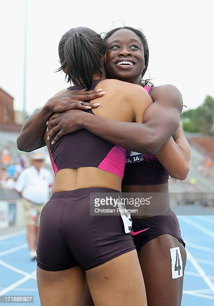 Jeneba Tarmoh hugs Allyson Felix following the Women's 200 Meter Dash final on day four of the 2013 USA Outdoor Track Field Championships at Drake...
