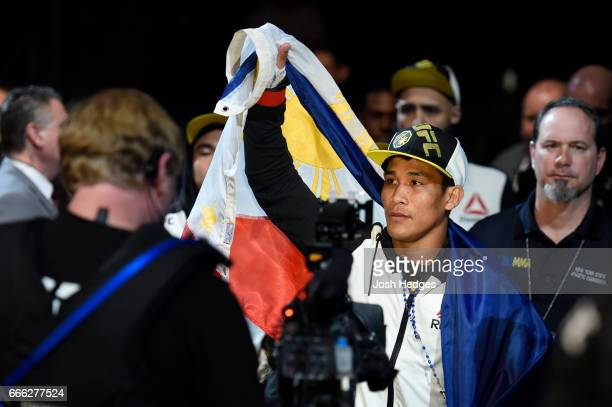 Jenel Lausa of the Philippines enters the octagon prior to the fight against Magomed Bibulatov of Russia in their flyweight bout during the UFC 210...