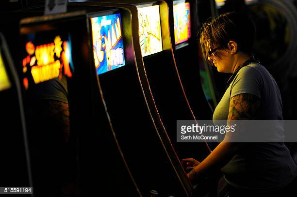 Jenette Skees plays a game of Pac Man at Hyperspace Arcade in Lakewood Colorado on March 10 2016 Hyperspace Arcade is an 80's themed arcade