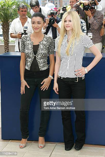 Jenifer Bartoli and Avril Lavigne during 2006 Cannes Film Festival 'Over The Hedge' Photocall at Palais des Festival in Cannes France